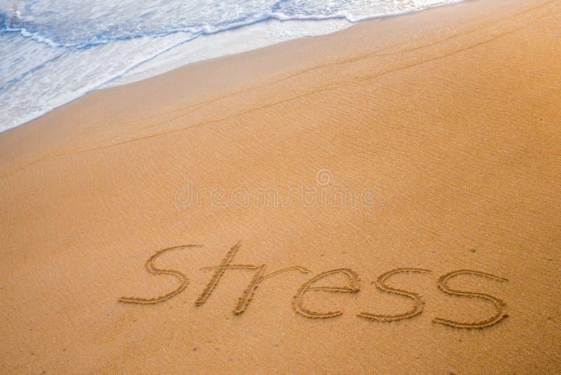 Η ΠΙΕΣΗ λέξης που γράφεται στην άμμο στοκ φωτογραφία με δικαίωμα ελεύθερης χρήσης