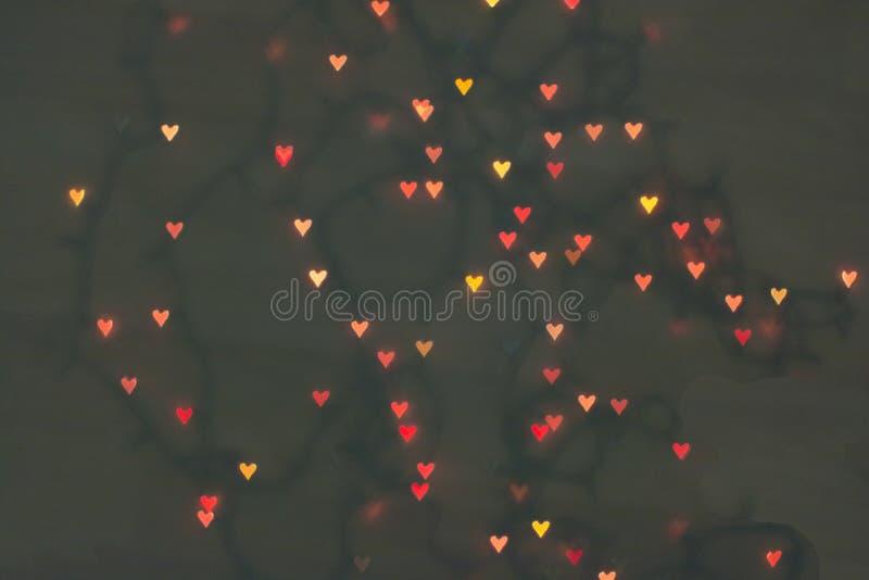 Η πλευρά υπό μορφή καρδιών Μικρά σύμβολα της καρδιάς αγάπης bokeh στοκ φωτογραφίες