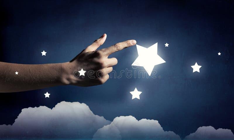 Η προσιτότητα και αγγίζει το αστέρι στοκ εικόνα με δικαίωμα ελεύθερης χρήσης