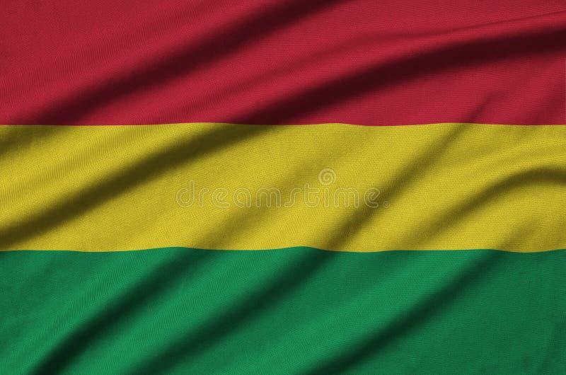 Η σημαία της Βολιβίας απεικονίζεται σε ένα ύφασμα αθλητικών υφασμάτων με πολλές πτυχές Έμβλημα αθλητικών ομάδων στοκ εικόνες