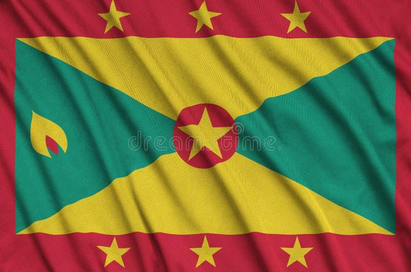 Η σημαία της Γρενάδας απεικονίζεται σε ένα ύφασμα αθλητικών υφασμάτων με πολλές πτυχές Έμβλημα αθλητικών ομάδων στοκ εικόνες