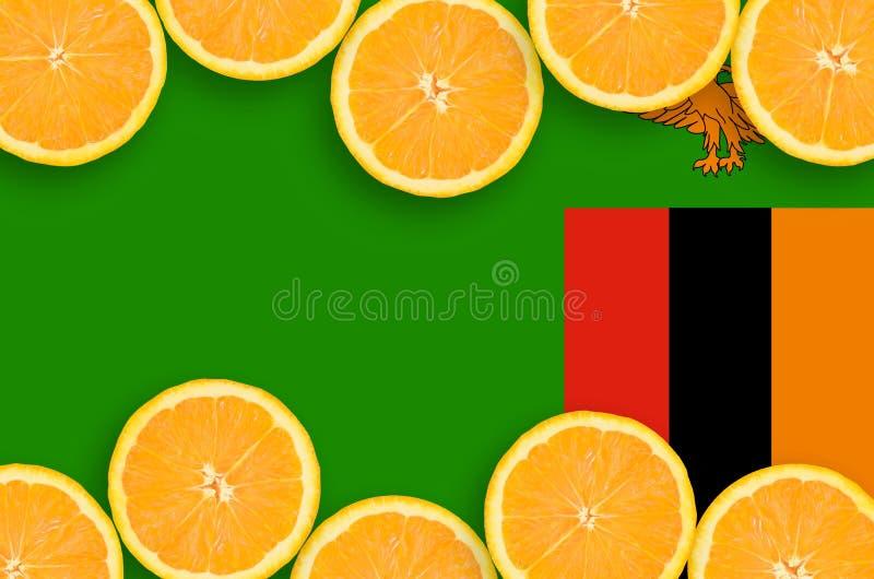 Η σημαία της Ζάμπια στο εσπεριδοειδές τεμαχίζει το οριζόντιο πλαίσιο στοκ εικόνα