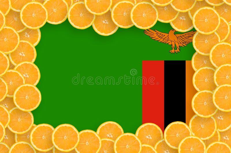 Η σημαία της Ζάμπια στο φρέσκο εσπεριδοειδές τεμαχίζει το πλαίσιο στοκ φωτογραφίες