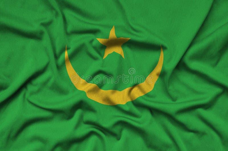 Η σημαία της Μαυριτανίας απεικονίζεται σε ένα ύφασμα αθλητικών υφασμάτων με πολλές πτυχές Έμβλημα αθλητικών ομάδων στοκ εικόνα με δικαίωμα ελεύθερης χρήσης