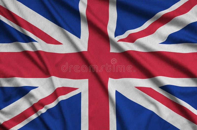 Η σημαία της Μεγάλης Βρετανίας απεικονίζεται σε ένα ύφασμα αθλητικών υφασμάτων με πολλές πτυχές Έμβλημα αθλητικών ομάδων στοκ εικόνα με δικαίωμα ελεύθερης χρήσης