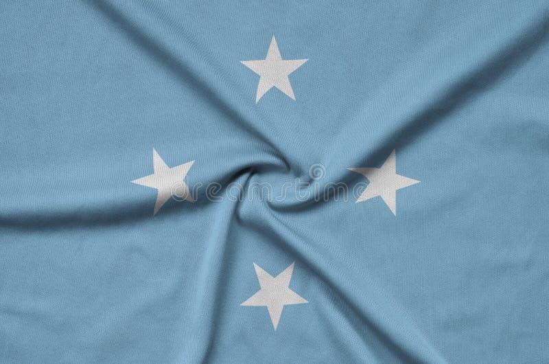 Η σημαία της Μικρονησίας απεικονίζεται σε ένα ύφασμα αθλητικών υφασμάτων με πολλές πτυχές Έμβλημα αθλητικών ομάδων στοκ φωτογραφίες
