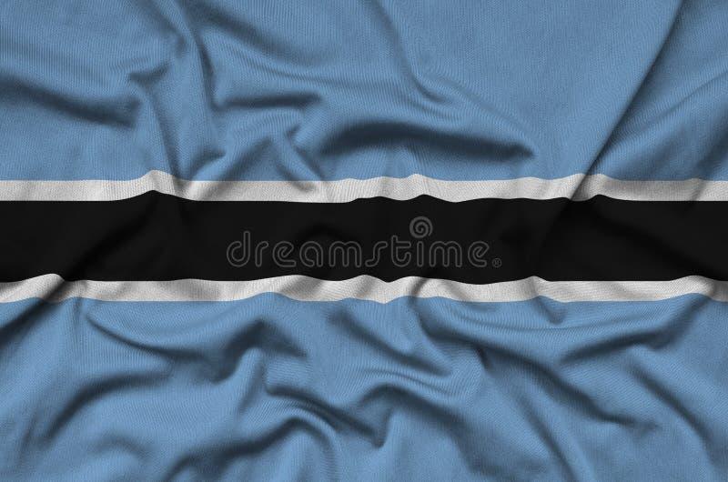 Η σημαία της Μποτσουάνα απεικονίζεται σε ένα ύφασμα αθλητικών υφασμάτων με πολλές πτυχές Έμβλημα αθλητικών ομάδων στοκ φωτογραφίες με δικαίωμα ελεύθερης χρήσης
