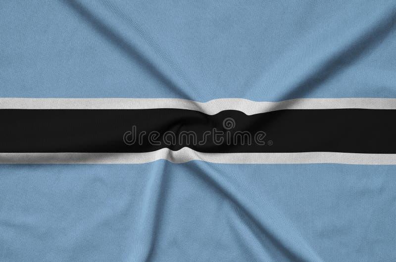Η σημαία της Μποτσουάνα απεικονίζεται σε ένα ύφασμα αθλητικών υφασμάτων με πολλές πτυχές Έμβλημα αθλητικών ομάδων στοκ φωτογραφίες