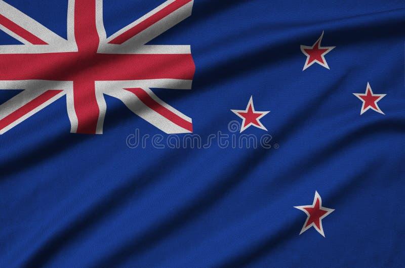 Η σημαία της Νέας Ζηλανδίας απεικονίζεται σε ένα ύφασμα αθλητικών υφασμάτων με πολλές πτυχές Έμβλημα αθλητικών ομάδων στοκ εικόνες