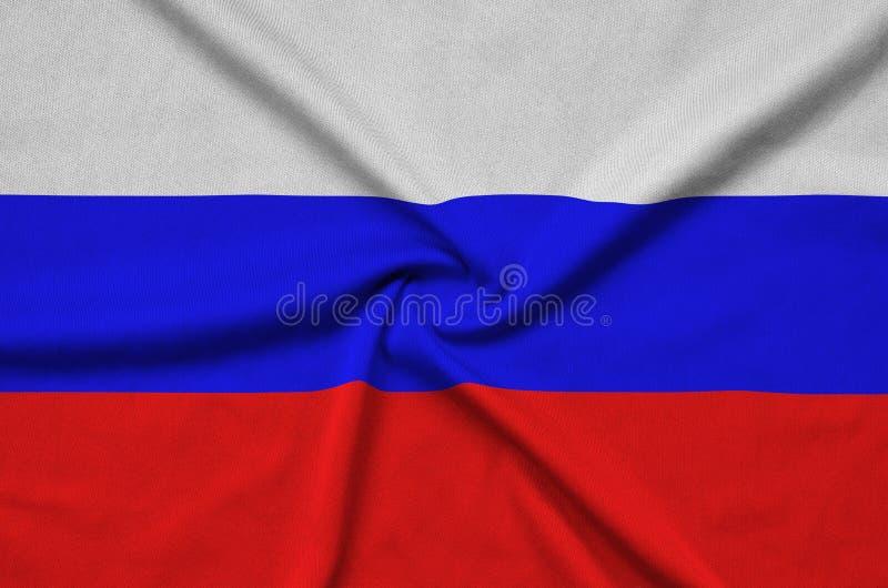 Η σημαία της Ρωσίας απεικονίζεται σε ένα ύφασμα αθλητικών υφασμάτων με πολλές πτυχές Έμβλημα αθλητικών ομάδων στοκ φωτογραφία με δικαίωμα ελεύθερης χρήσης