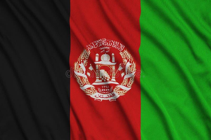 Η σημαία του Αφγανιστάν απεικονίζεται σε ένα ύφασμα αθλητικών υφασμάτων με πολλές πτυχές Έμβλημα αθλητικών ομάδων στοκ φωτογραφία