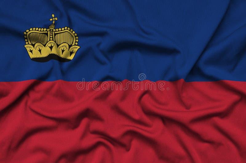 Η σημαία του Λιχτενστάιν απεικονίζεται σε ένα ύφασμα αθλητικών υφασμάτων με πολλές πτυχές Έμβλημα αθλητικών ομάδων στοκ εικόνα