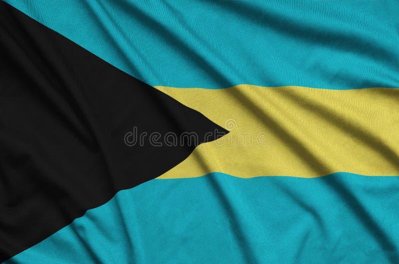 Η σημαία των Μπαχαμών απεικονίζεται σε ένα ύφασμα αθλητικών υφασμάτων με πολλές πτυχές Έμβλημα αθλητικών ομάδων στοκ φωτογραφίες με δικαίωμα ελεύθερης χρήσης