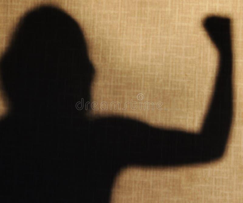 Η σκιά παρουσιάζει χέρι για ισχυρό στοκ φωτογραφίες