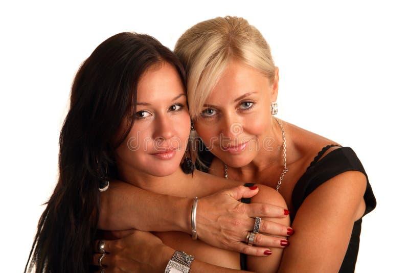 η συμπάθεια κορών αγκαλι στοκ εικόνα με δικαίωμα ελεύθερης χρήσης