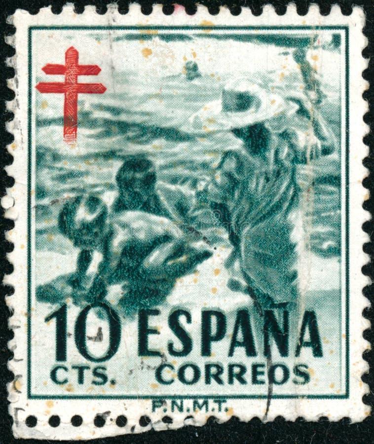 Η σφραγίδα συγκομιδής τυπώθηκε στην Ισπανία το 1951 δείχνει τα παιδιά στο Seashore, Εθνική Αντιφυματική Εκστρατεία στοκ εικόνες με δικαίωμα ελεύθερης χρήσης