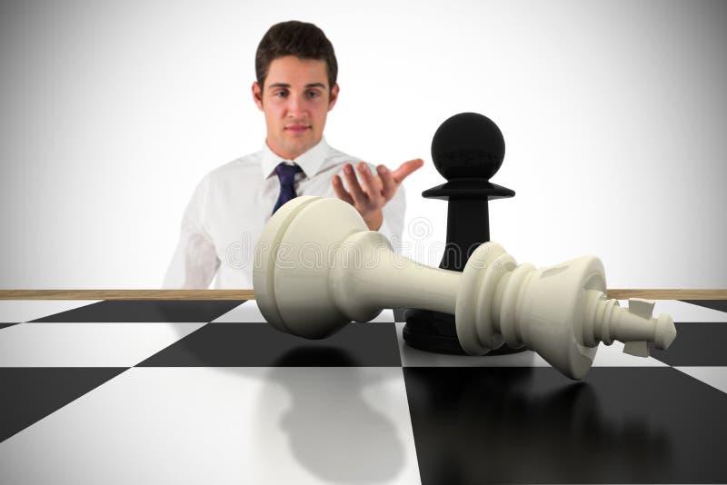 Η σύνθετη εικόνα του επιχειρηματία που στέκεται με διανέμει στοκ φωτογραφία