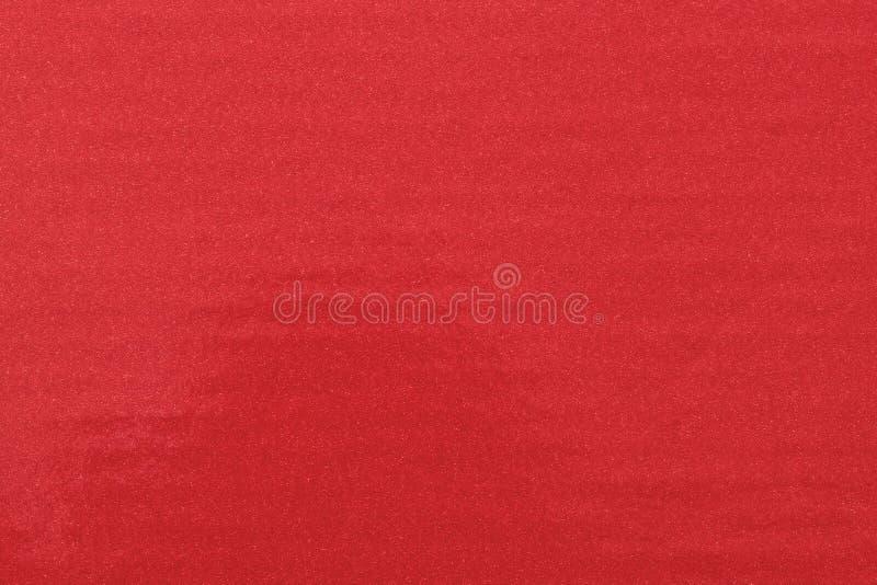 Η σύσταση ακτινοβολεί κόκκινο χρώμα στο πλαστικό φύλλο, αφηρημένο υπόβαθρο σχεδίων στοκ φωτογραφίες με δικαίωμα ελεύθερης χρήσης