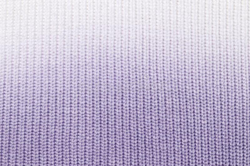 Η σύσταση ενός πλεκτού μάλλινου μπλε υφάσματος στοκ εικόνες