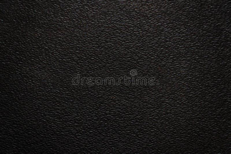 Η σύσταση της μαύρης πλαστικής ραβδωτής επιφάνειας στοκ φωτογραφία με δικαίωμα ελεύθερης χρήσης