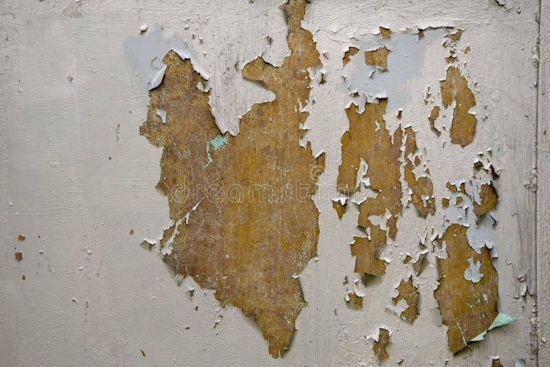 Η σύσταση του γρατζουνισμένου χρώματος στην πόρτα στοκ εικόνα