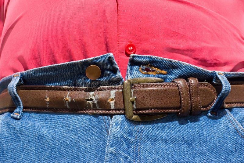 η τρύπα ζωνών διαρκεί την παχυσαρκία στοκ φωτογραφία με δικαίωμα ελεύθερης χρήσης