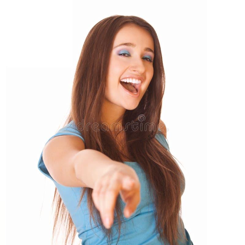 Η χαμογελώντας γυναίκα εμφανίζει προς τα εμπρός σε σας στοκ εικόνα