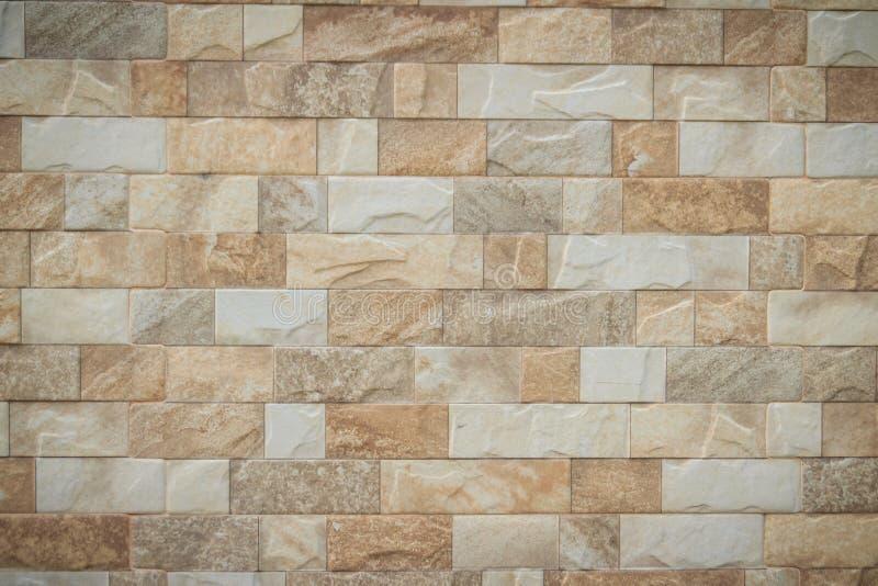 Η χαρακτηρισμένη πέτρα κεραμώνει τη σύσταση υποβάθρου τοίχων Καθαρίστε και συνηθισμένο στοκ φωτογραφίες