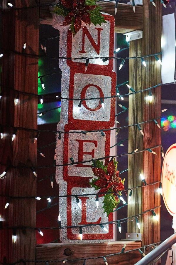 Η Χαρούμενα Χριστούγεννα ανάβει noel στοκ φωτογραφία