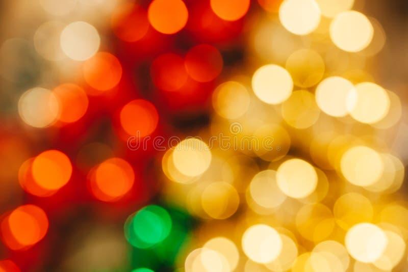 Η χρυσή και κόκκινη λαμπρή περίληψη θόλωσε bokeh χρησιμοποιημένος για το υπόβαθρο διακοπών ή Χριστουγέννων στοκ φωτογραφίες με δικαίωμα ελεύθερης χρήσης