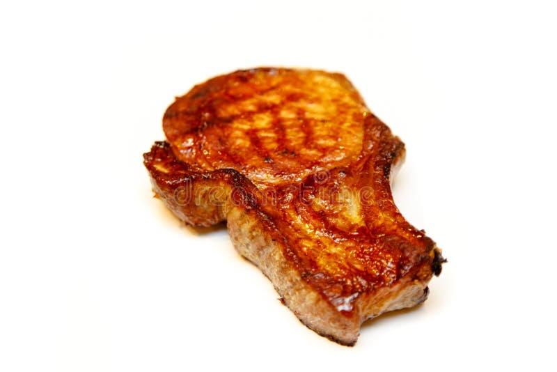 Η ψημένη οσφυϊκή χώρα χοιρινού κρέατος στο κόκκαλο κόβεται στις μπριζόλες μια άσπρη πλάτη στοκ εικόνες
