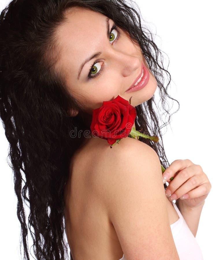 Η όμορφη γυναίκα με αυξήθηκε στοκ φωτογραφίες