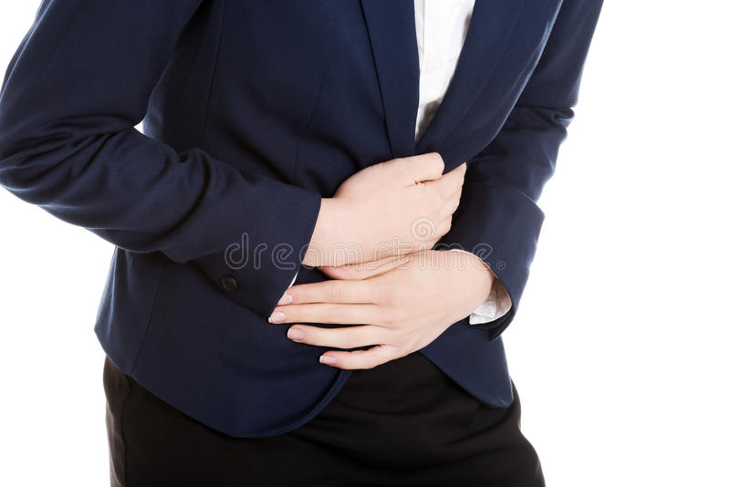 Η όμορφη επιχειρησιακή γυναίκα αγγίζει το στομάχι της. στοκ φωτογραφίες