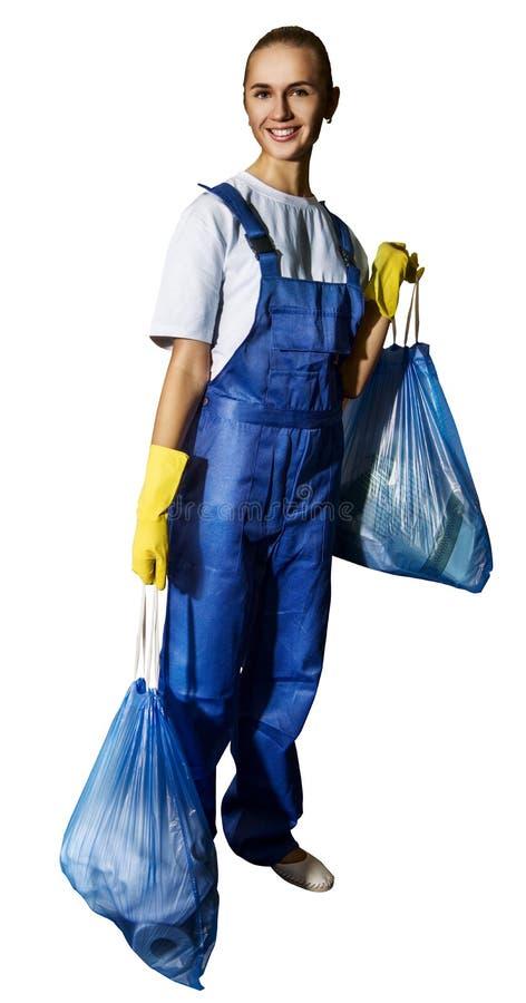 Η όμορφη νέα γυναίκα κάνει τον καθαρισμό του σπιτιού στοκ φωτογραφία