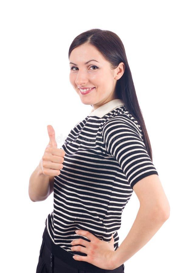 Η όμορφη νέα γυναίκα που παρουσιάζει αντίχειρα υπογράφει επάνω στοκ φωτογραφία με δικαίωμα ελεύθερης χρήσης