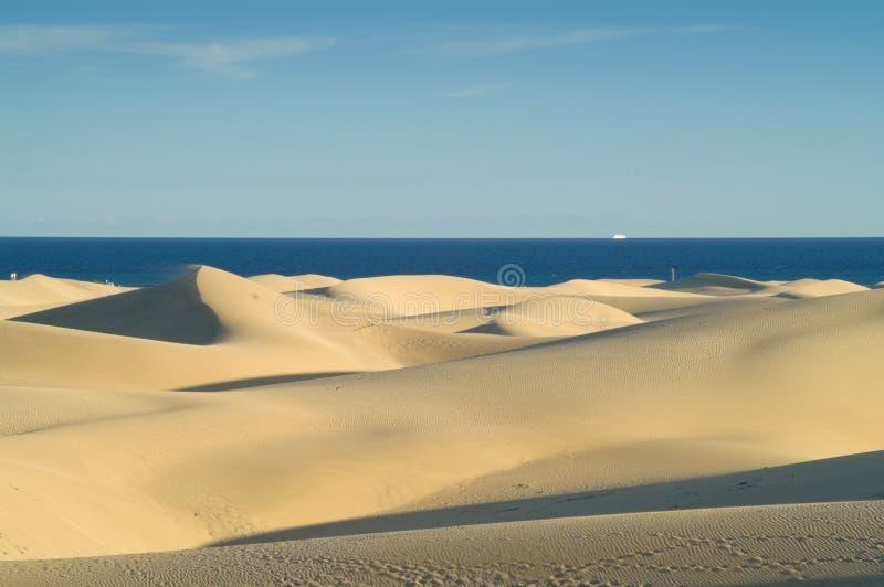 θάλασσα άμμου αμμόλοφων στοκ εικόνες