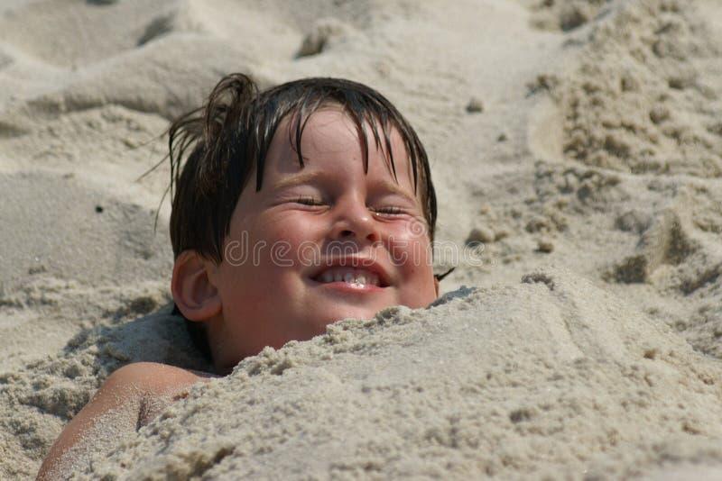θαμμένη άμμος στοκ φωτογραφία