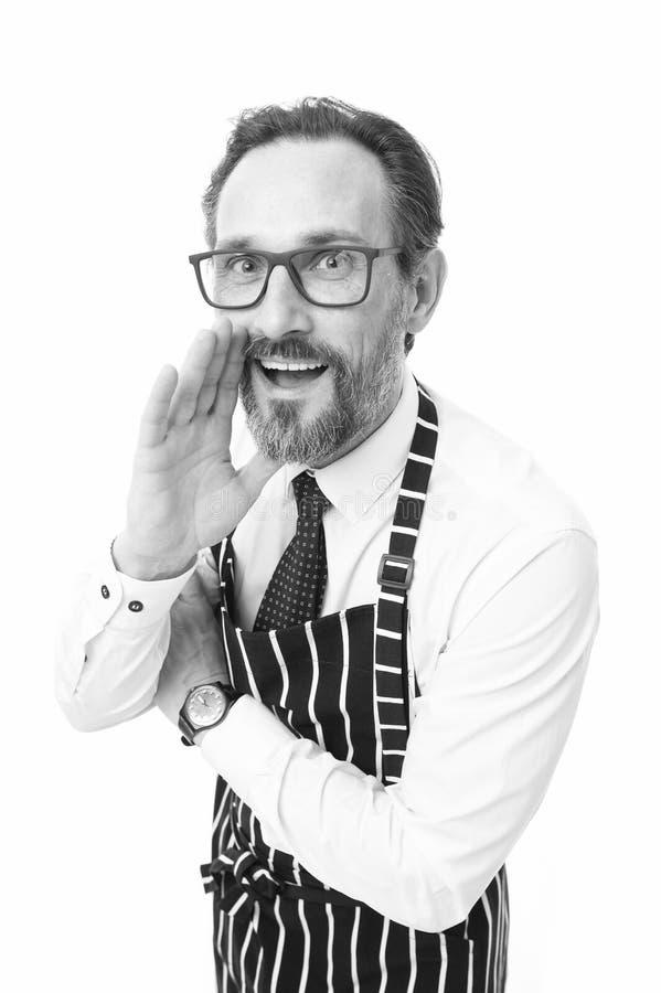 Θελήστε να ξέρετε τη μυστική συνταγή μου Μάγειρας ατόμων στο άσπρο υπόβαθρο ποδιών Επαγγελματικό επάγγελμα Μυστικές άκρες μεριδίο στοκ φωτογραφία με δικαίωμα ελεύθερης χρήσης