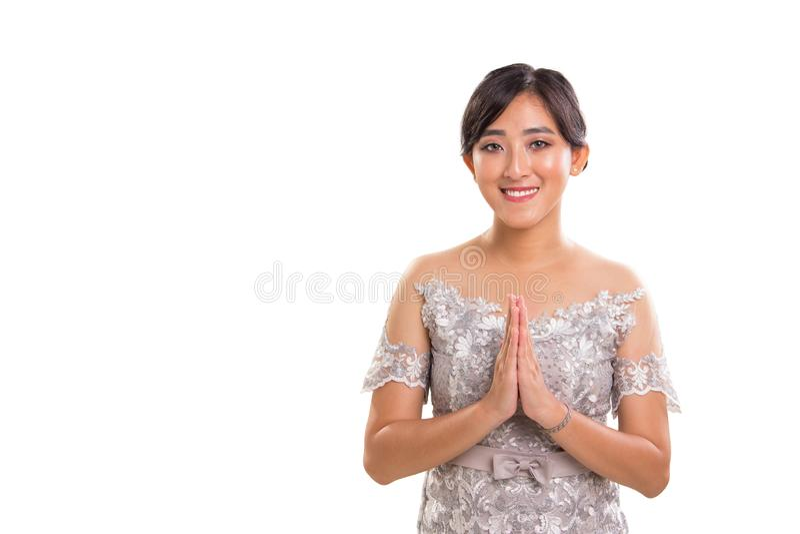 Θερμός χαιρετισμός της νέας ελκυστικής εθνικής Νοτιοανατολικής Ασίας θηλυκό μ στοκ εικόνες
