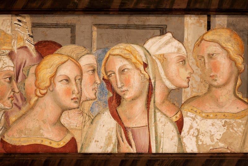 Θηλυκά κεφάλια στη 14η νωπογραφία αιώνα μέσα ιστορικό Palazzo del Podesta στοκ εικόνες