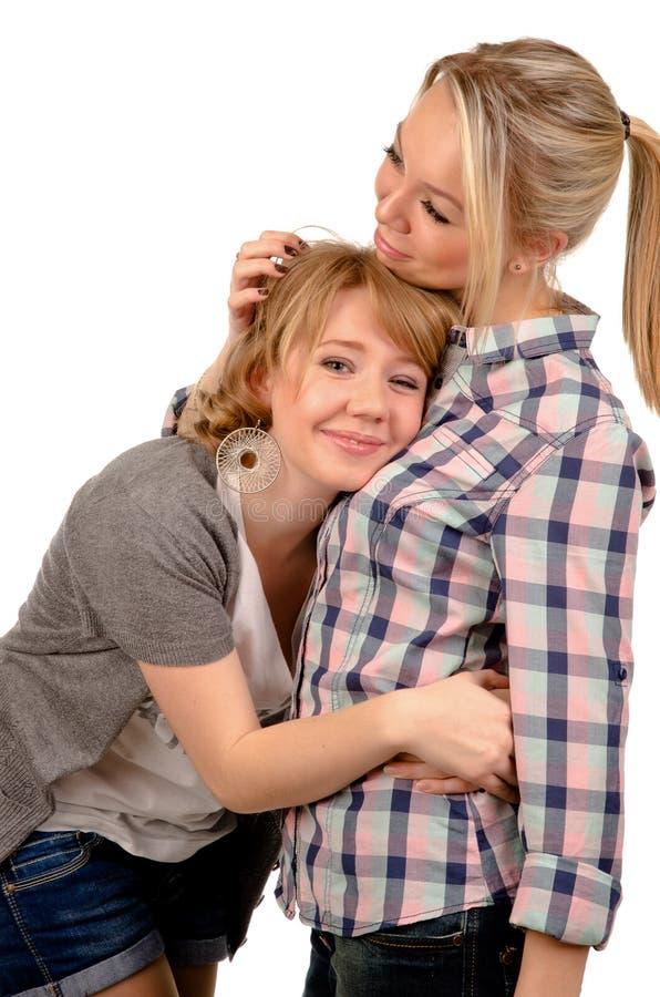 Θηλυκοί φίλοι που παίρνουν την άνεση από στοκ φωτογραφία