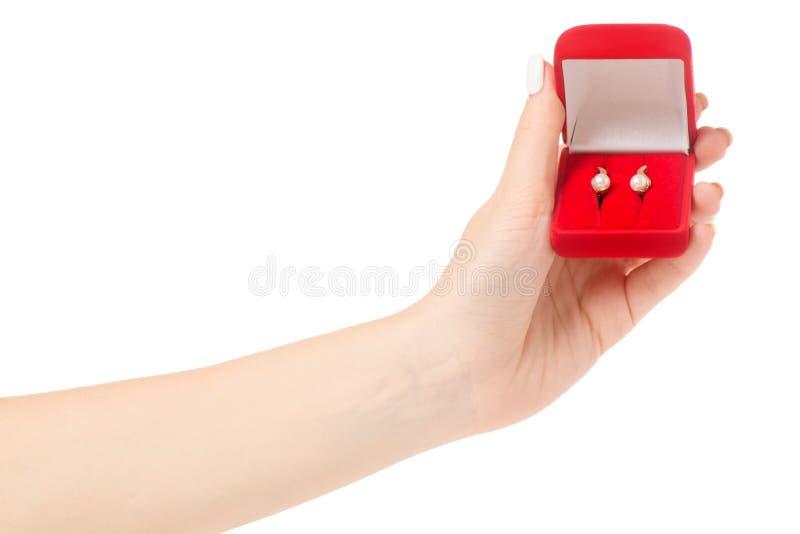Θηλυκό κιβώτιο εκμετάλλευσης χεριών για το κόκκινο σκουλαρικιών κοσμήματος στοκ φωτογραφίες