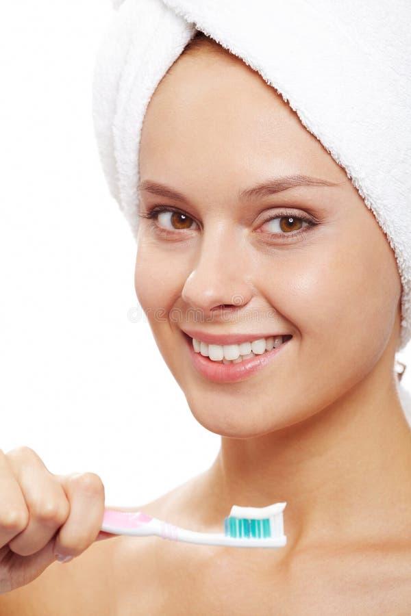 Θηλυκό με την οδοντόβουρτσα στοκ φωτογραφία