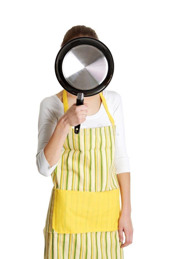 θηλυκό που τηγανίζει το&nu στοκ εικόνα