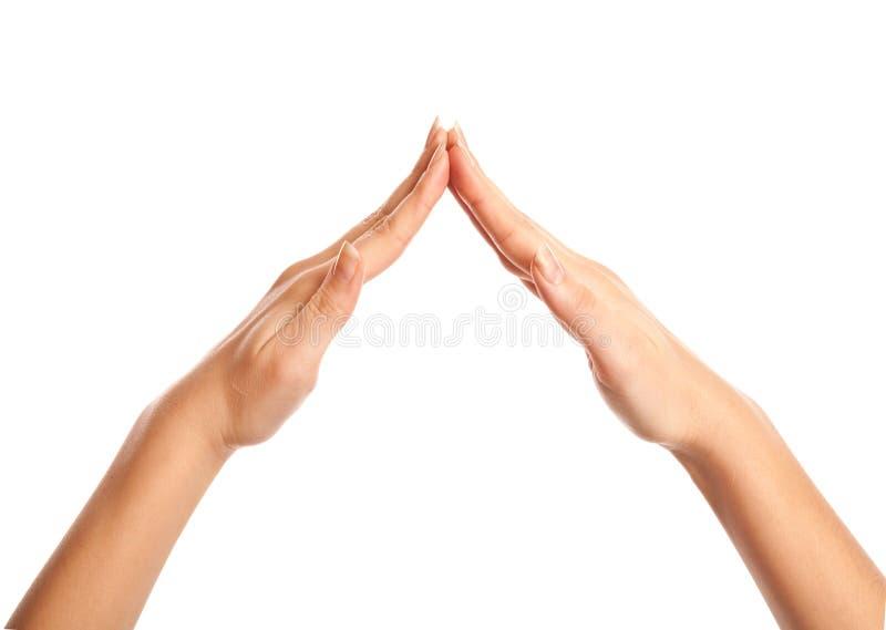 θηλυκό σπίτι χεριών διαμόρφ&o στοκ εικόνες με δικαίωμα ελεύθερης χρήσης