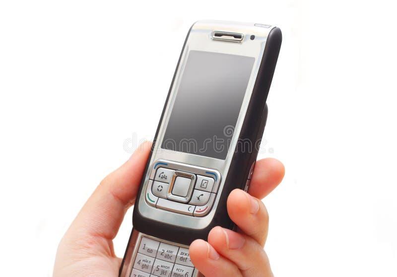 θηλυκό χέρι κινητών τηλεφών&ome στοκ εικόνες