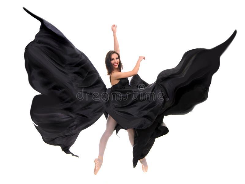 Θηλυκός χορευτής μπαλέτου στο μαύρο σατέν στοκ φωτογραφίες με δικαίωμα ελεύθερης χρήσης