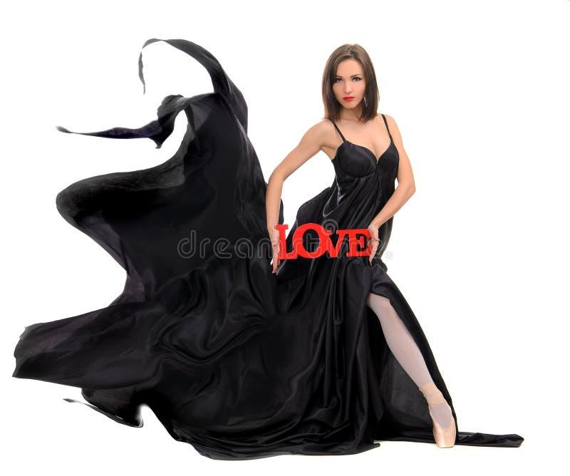 Θηλυκός χορευτής στη μαύρη εσθήτα στοκ φωτογραφίες