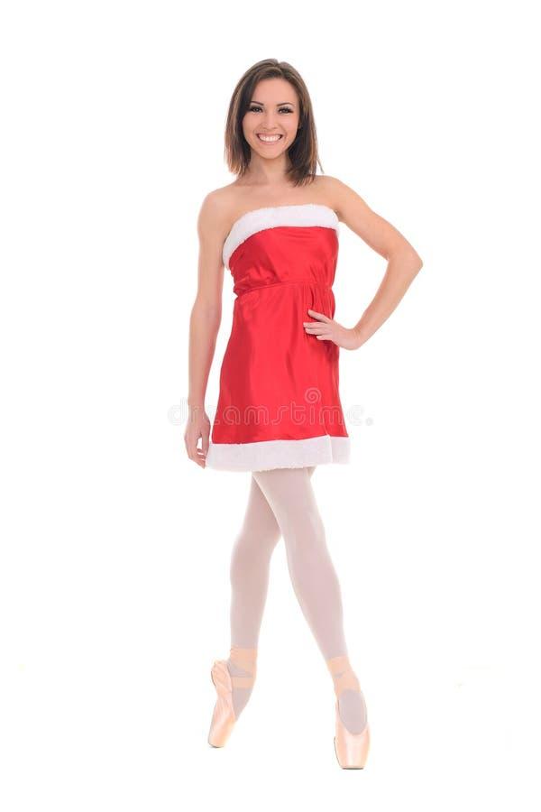 Θηλυκός χορευτής στο φόρεμα Χριστουγέννων στοκ φωτογραφία
