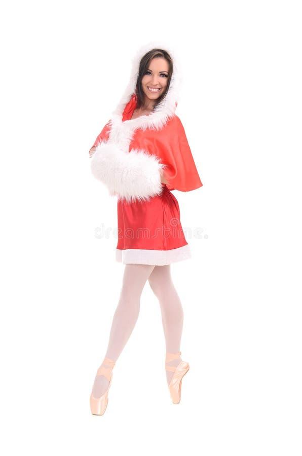 Θηλυκός χορευτής στο φόρεμα Χριστουγέννων στοκ εικόνες